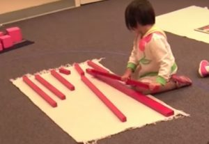 Montessori Sensory Activity Red Rods of Varying Lengths