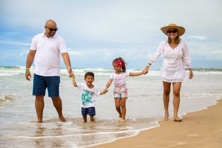 Prosperous Family on Vacation at the Beach